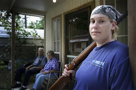 Shannon Morgan, a female soldier in an engineering unit featured in the film ''Lioness,'' is seen here on the porch of her family's Mena, Arkansas home in this undated handout photo. REUTERS/Steve Maning/Handout