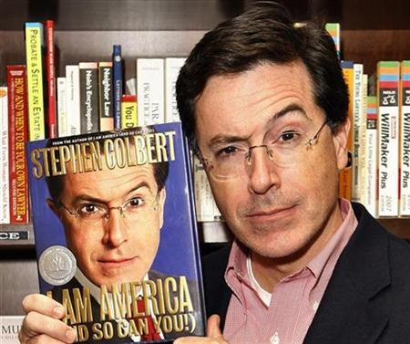 Stephen Colbert poses with his new book ''I Am America (And So Can You!)'' at a book signing in New York October 24, 2007. REUTERS/Lucas Jackso