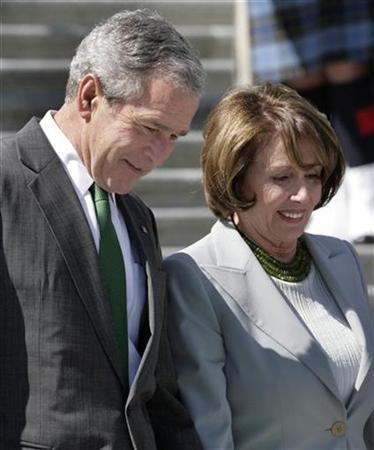 President George W. Bush and House Speaker Nancy Pelosi walk down the steps of the U.S. Capitol in Washington after attending St. Patrick's Day luncheon, March 17, 2008. REUTERS/Yuri Gripas