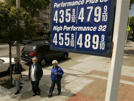 Women view a sign advertising the price of gasoline at a filling station in San Francisco, April 28, 2008. REUTERS/Robert Galbraith