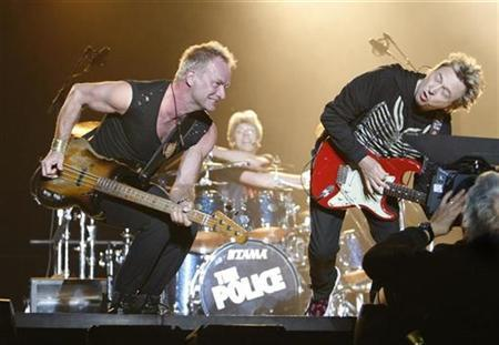 Bassist and lead singer Sting (L), drummer Stewart Copeland (C) and guitarist Andy Summers perform during The Police Live in Concert in Tokyo February 13, 2007. REUTERS/Issei Kato