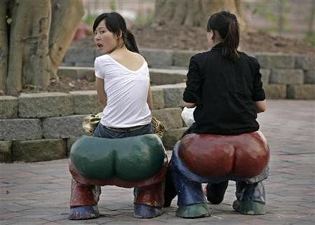 Women sit on specially designed seats at a park in southwest China's Chongqing municipality, April 20, 2007. A type of fat that accumulates around the hips and bottom may actually offer some protection against diabetes, U.S. researchers said on Tuesday. REUTERS/Reinhard Krause