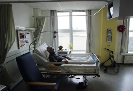 An unidentified man suffering from Alzheimer's disease sleeps peacefully the day before passing away in a nursing home in the Netherlands. REUTERS/Michael Kooren