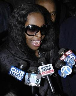 Rap artist Inga Marchand, also known as Foxy Brown, departs from a superior court after being sentenced to three years probation on assault charges, in New York October 24, 2006. REUTERS/Chip East
