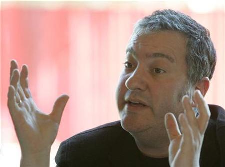 photographer Spencer Tunick gestures during a news conference in Vienna May 7, 2008. REUTERS/Herwig Prammer