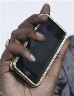 A customized, bejewelled Apple iPhone is pictured at the premiere of the film ''Tyler Perry's Meet The Browns'' in Hollywood, California March 13, 2008. REUTERS/Fred Prouser