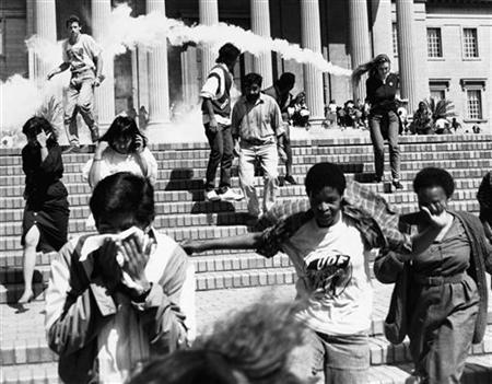 Student demonstrators at Johannesburg's Witwatersrand University flee as police fire tear gas at them during an anti-apartheid protest rally, August 31, 1989. Apartheid ended in 1994 when South Africa held its first all-race elections, bringing Nelson Mandela and the African National Congress to power. REUTERS/Ulli Michel