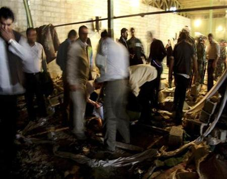 Officials search inside a mosque after a bomb explosion in Shiraz April 13, 2008. REUTERS/Jamejamonline