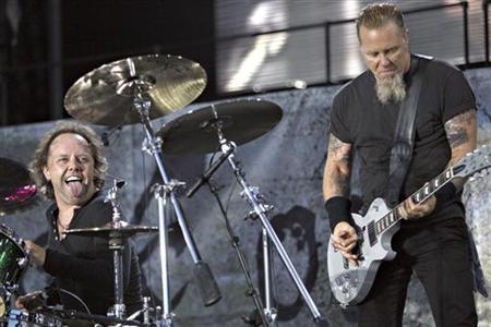 U.S. heavy metal band Metallica's drummer Lars Ulrich (L) and guitarist James Hetfield perform on stage during a concert in Aarhus, western Denmark July 13, 2007. REUTERS/ Claus Fisker/Scanpix