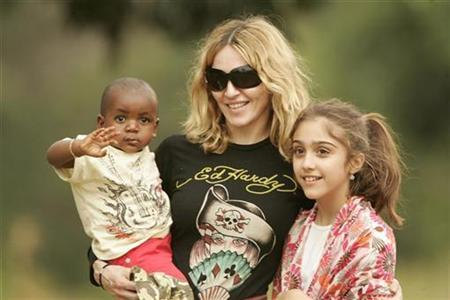 Madonna carries her adopted son David at the Home of Hope orphanage in Mchinji village, 84 miles west of the capital Lilongwe, April 17, 2007. At right is Madonna's daughter Lourdes. REUTERS/Siphiwe Sibeko
