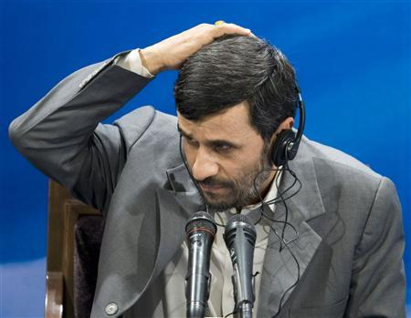 Iranian President Mahmoud Ahmadinejad listens to a question from a journalist during a news conference in Tehran May 13, 2008. REUTERS/Raheb Homavandi