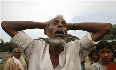 A man cries after a relative was killed, in Titkumar village 83 miles south from the eastern Indian city of Kolkata May 14, 2008. REUTERS/Jayanta Shaw