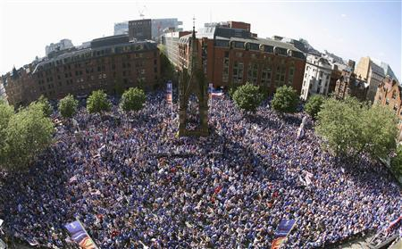 Rangers fans fill Albert Square to watch their team play Zenit St. Petersburg in the UEFA Cup final match on TV screens in central Manchester, May 14, 2008. REUTERS/Darren Staples