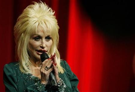 Dolly Parton speaks at the launch of her Imagination Library book project at the Magna Centre in Sheffield, northern England December 5, 2007. REUTERS/Nigel Roddis