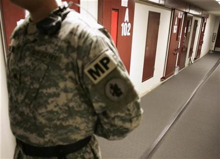 A U.S. Army guard stands in a corridor of cells in Camp Five, a detention facility at the Guantanamo Bay Naval Station in Guantanamo Bay, Cuba September 4, 2007. REUTERS/Joe Skipper
