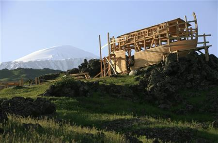 A man rests on the entrance of a modern day version of the legendary Noah's Ark on Mount Ararat at dawn in eastern Turkey in this May 22, 2007 file photo. REUTERS/Fatih Saribas/Files