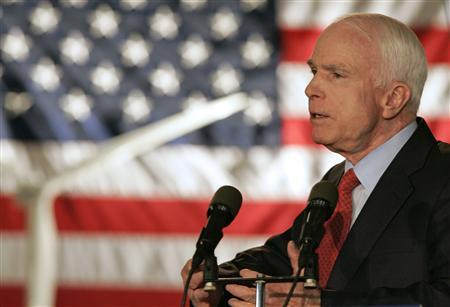 US Republican presidential candidate Senator John McCain (R-AZ) addresses employees about alternative energy sources in front of a wind turbine model at the Vestas Wind Technology plant in Portland, Oregon May 12, 2008. REUTERS/Richard Clement