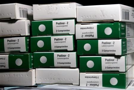 Boxes of the contraceptive Postinor-2, known as the ''morning-after pill'', are seen inside a safe in a public health clinic in Santiago September 22, 2006. REUTERS/Ivan Alvarado