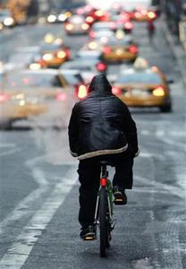 A man cycles into Manhattan in a file photo. It's U.S. National Bike to Work Day on Friday and Americans are facing record high gasoline prices, but most commuters will stick to their cars. REUTERS/Peter Foley