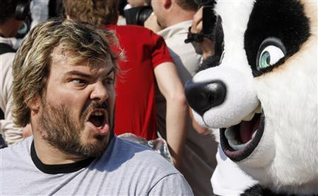 Voice actor Jack Black shouts near life-sized pandas during a beach photo call for the animated film ''Kung Fu Panda'' as the 61st Cannes Film Festival starts, May 14, 2008. REUTERS/Jean-Paul Pelissier