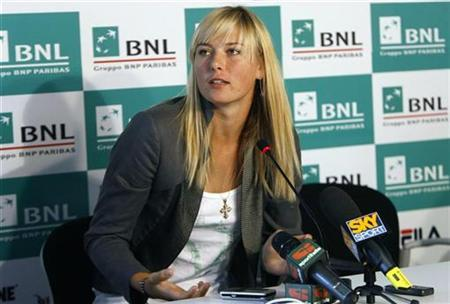 Maria Sharapova of Russia attends a news conference to explain the reasons she quit the Italy Masters Series tennis tournament in Rome, May 17, 2008. REUTERS/Dario Pignatell