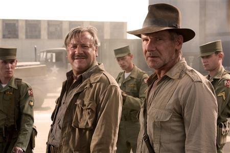 Actors Ray Winstone (L) and Harrison Ford are shown in a scene from the new film ''Indiana Jones and the Kingdom of the Crystal Skull'' in this undated publicity photograph. REUTERS/David James/Paramount Pictures/Handout