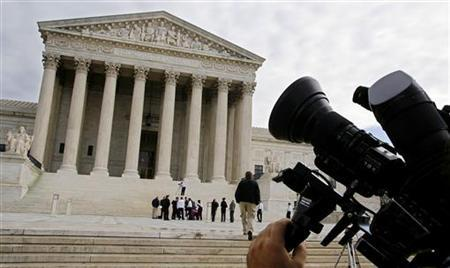 A television camera is pointed at the Supreme Court building in Washington, November 28, 2005. REUTERS/Joshua Roberts