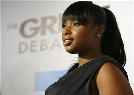 Actress Jennifer Hudson poses at the premiere of ''The Great Debaters'' at the Arclight Cinerama Dome in Hollywood, California on December 11, 2007.Hudson plans to release her self-titled debut album in September, with the first single, ''Spotlight,'' hitting U.S. radio outlets in June, her label said on Monday. REUTERS/Mario Anzuoni