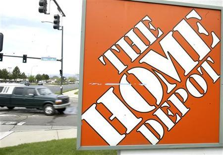 A truck pulls into the parking lot of a Home Depot store in a suburb of Denver, Colorado May 17, 2005. REUTERS/Rick Wilking