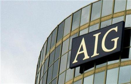 A sign on an office building for AIG, American International Group, is pictured in Los Angeles, California May 8, 2008. REUTERS/Fred Prouser