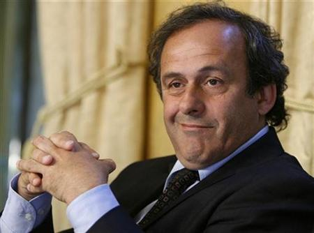 UEFA President Michel Platini smiles during a news conference at the Geneva Press Club in Geneva April 29, 2008. REUTERS/Denis Balibouse