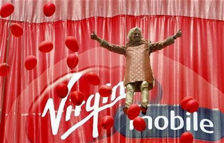 Virgin Group Chairman Richard Branson dangles on a rope to unveil the Virgin Mobile logo in Mumbai March 2, 2008. REUTERS/Punit Paranjpe