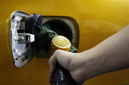 A worker is seen filling up a taxi's fuel tank at a gas station in Taipei in this April 23, 2008 file photo. REUTERS/Nicky Loh/Files