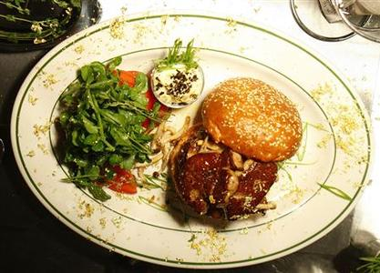 A $175 Hamburger, is prepared at The Wall Street Burger Shoppe in New York May 13, 2008. The Wall Street Burger Shoppe just raised its price from $150 to assure its designation as the most expensive burger in the city as determined by Pocket Change, an online newsletter about the most expensive things in New York. REUTERS/Brendan McDermid