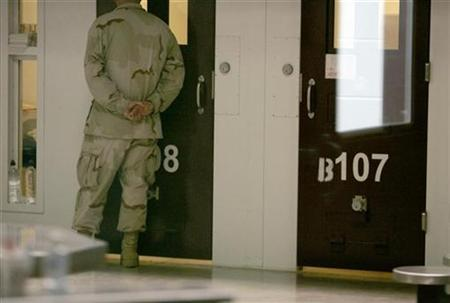 A guard checks cells in the maximum security Camp Six at the Guantanamo Bay Naval Station in Guantanamo Bay, Cuba, September 4, 2007. A Saudi citizen who allegedly intended to be the ''20th hijacker'' on September 11 tried to kill himself last month at the prison camp in Guantanamo after learning he faced charges that could carry the death penalty, his lawyer said on Monday. REUTERS/Joe Skipper