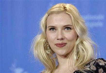 Actress Scarlett Johansson poses during a photocall at the 58th Berlinale International Film Festival in Berlin, February 15, 2008. Johansson's latest film work may be getting the red carpet treatment at Cannes, but her debut album, released on Tuesday, is drawing fire from music critics. REUTERS/Johannes Eisele