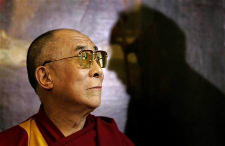 Tibetan spiritual leader Dalai Lama is seen in front of a shadow of of British lawmaker Norman Baker during a news conference in Westminster, London May 21, 2008. REUTERS/Kirsty Wigglesworth/Pool