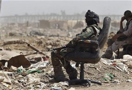 An Iraqi soldier takes a rest during a joint mopping-up operation with U.S. soldiers from Bravo Company, 1-22 Infantry Battalion on the edge of Shiite dominated Baghdad's neighbourhood of Shulla, May 20, 2008. REUTERS/Oleg Popov