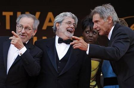 Steven Spielberg (L), producer George Lucas (C), Melody Hobson (2nd R) and Harrison Ford speak before the world premiere screening of the film ''Indiana Jones and the Kingdom of the Crystal Skull'' at the 61st Cannes Film Festival May 18, 2008. REUTERS/Jean-Paul Pelissier