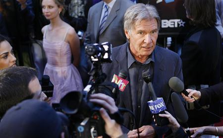 Cast member Harrison Ford is interviewed as he arrives for a screening of the film ''Indiana Jones and the Kingdom of the Crystal Skull'' by U.S. director Steven Spielberg in New York May 20, 2008. REUTERS/Lucas Jackson