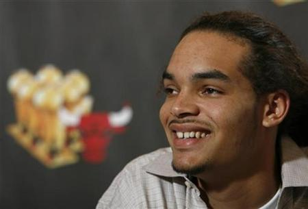 Chicago Bulls draftee Joakim Noah smiles during a news conference in Deerfield, Illinois July 2, 2007. REUTERS/John Gress