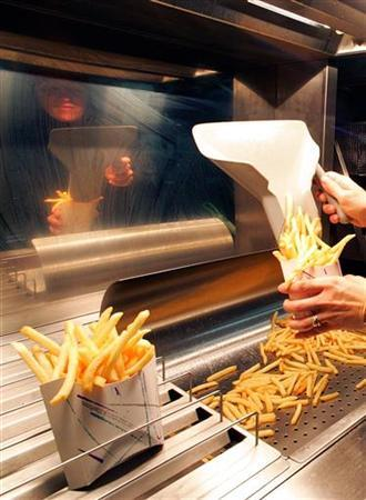 French fries are served in a file photo. REUTERS/Jacky Naegelen