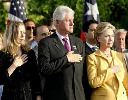 U.S. Democratic presidential candidate Sen. Hillary Clinton, her husband former President Bill Clinton and daughter Chelsea listen to national anthems during a Memorial Day ceremony in San Juan, Puerto Rico, May 26, 2008. REUTERS/Ana Martinez