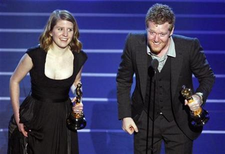 Glen Hansard (R) and Marketa Irglova accept the Oscar for the best original song ''Falling Slowly'' during the 80th annual Academy Awards in Hollywood February 24, 2008. REUTERS/Gary Hershorn