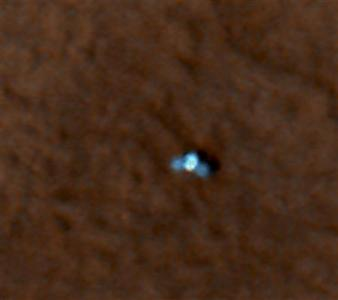 NASA's Mars Phoenix Lander can be seen with its solar panels deployed on the Mars surface in this image captured from Nasa's Mars Reconnaissance Orbiter, May 27, 2008. REUTERS/NASA/JPL-Caltech/University of Arizona/Handout.