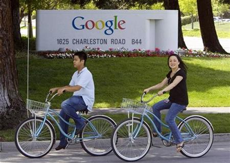 People ride their bikes past Google headquarters in Mountain View, California, May 8, 2008. REUTERS/Kimberly White