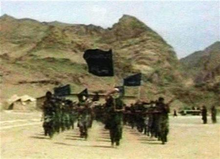 Recruits of Saudi-born Islamic militant Osama bin Laden are seen marching in this frame grab from an undated training video at an undisclosed location in Afghanistan. REUTERS/Stringer