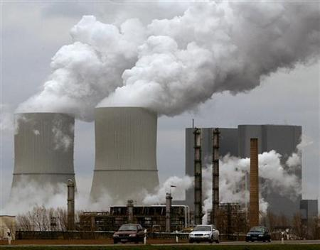 Cars drive past a plant of chemical producer Dow near the eastern German village of Lippendorf south of Leipzig March 25, 2004. REUTERS/Arnd Wiegmann