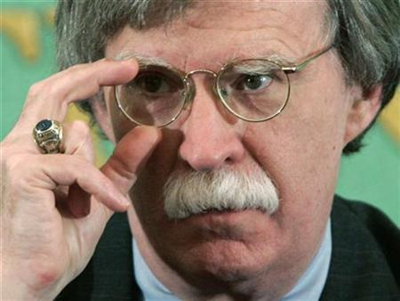 Former Ambassador to the United Nations John Bolton adjusts his glasses during a news conference at the Japan National Press Club in Tokyo January 17, 2007. REUTERS/Issei Kato