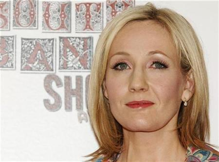 J.K. Rowling poses at The South Bank Show Awards at Dorchester Hotel in London January 29, 2008. The secret of what happened before boy wizard Harry Potter went to Hogwarts will be revealed through the unusual channel of a charity auction next month. REUTERS/Anthony Harvey
